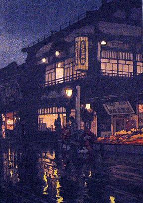 A Hiroshi Yoshida woodblock print entitled Kagurazaka Street after a Night Rain