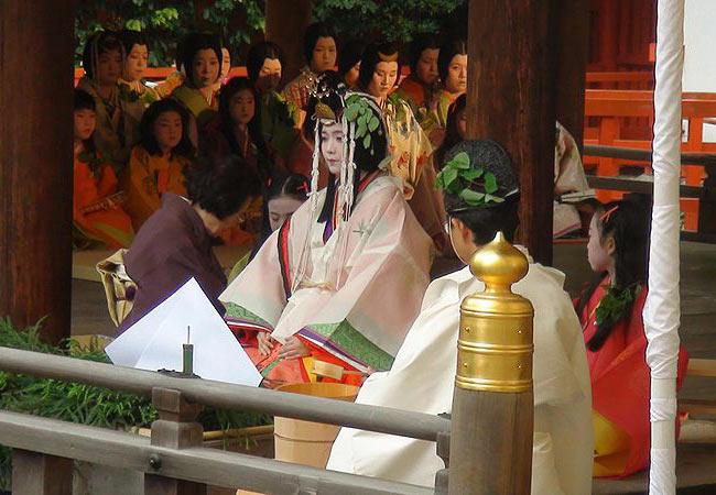 "Saio Dai of Aoi Matsuri Festival doing ""Misogi no gi"" at Shimogamo Jinja."