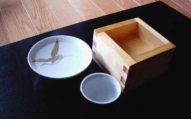 Three different sake cups; one of which is a masu.
