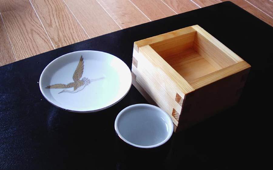 Drink sake at a Kyoto distillery.