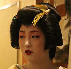 A geisha with the Taka Shimada hairstyle.