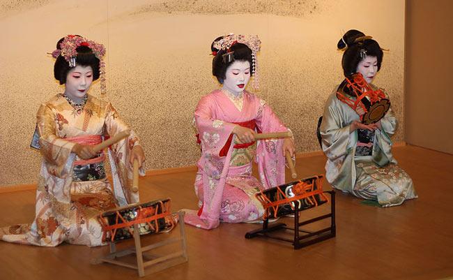 Three maiko's wearing kimono's.