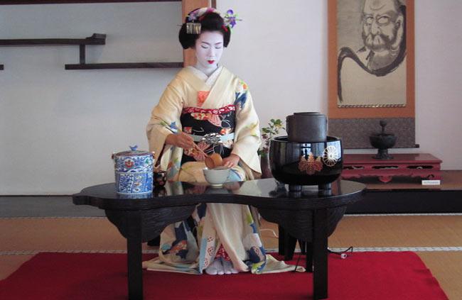 A geisha partaking in a tea ceremony.