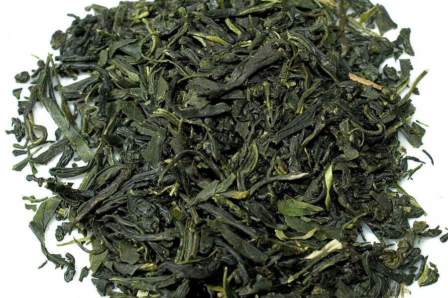 A small pile of Tamaryokucha tea leaves.
