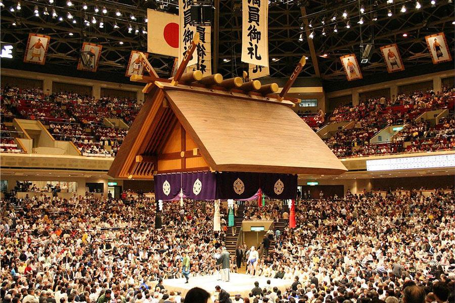 Watch sumo in Tokyo at the Ryogoku Kokugikan stadium.