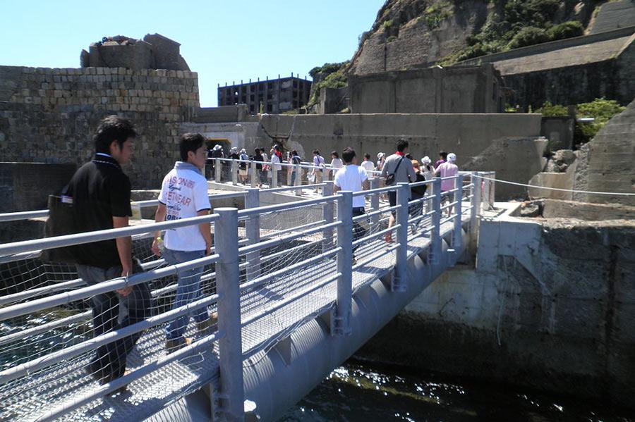 Tourists arriving on Hashimi Island, Nagasaki.