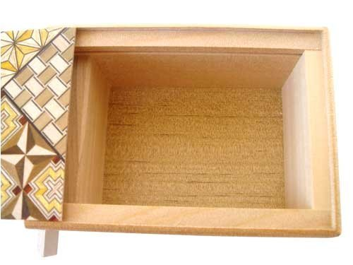 Open Japanese woodblock puzzle box.