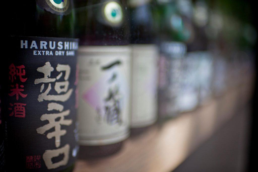 Bottles of different types of sake.