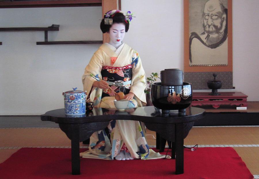 A geisha preparing ceremonial tea.