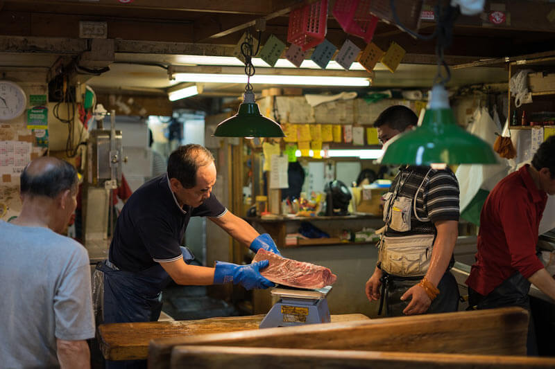 Fish being weighed at a Tokyo Fish market.
